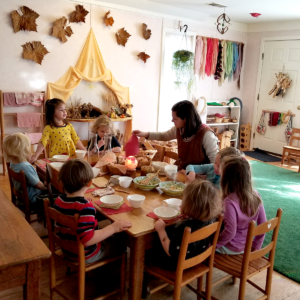 Charlottesville Waldorf School nursery students snack together around the table